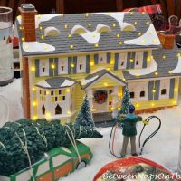 The Griswold Holiday House, Dept. 56 Lit House in Christmas Table Setting