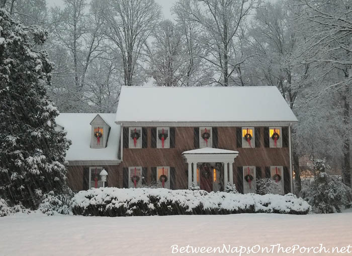 Christmas House with Wreaths in Snow