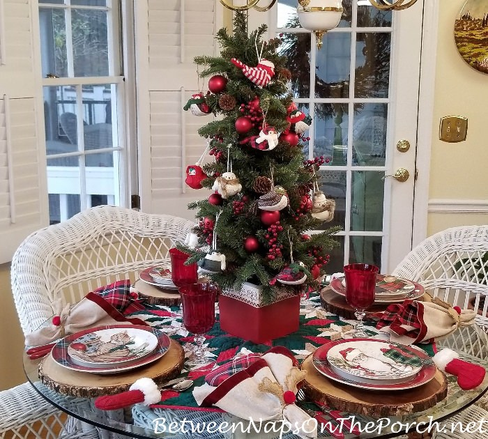 Christmas Table Setting with Tree and Bird Centerpiece