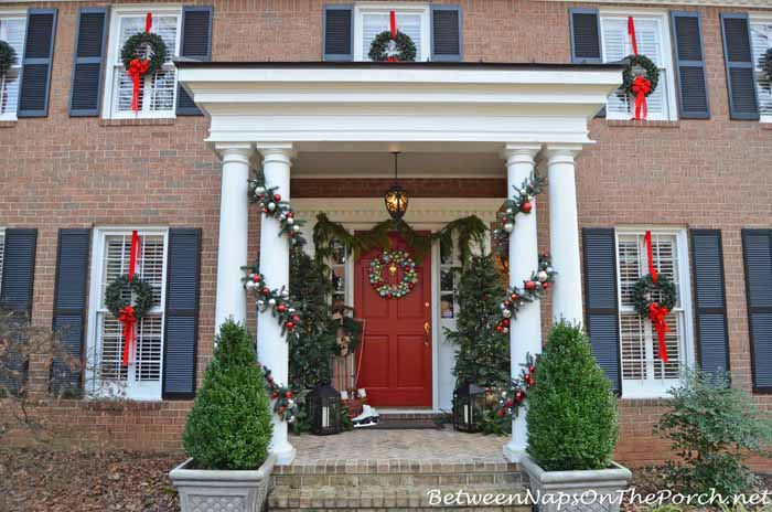 Decorate Porch For Christmas with Lit Topiary Trees