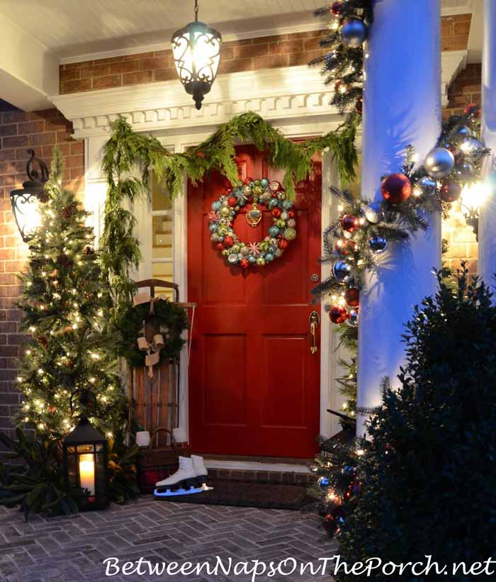 Porch Decorated With Lanterns and Lit Christmas Trees