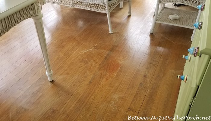 Sweeping Up Pollen Before Mopping Porch Floor