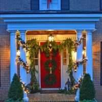 Christmas Porch Decorated with Garland and Boxwood Wreaths