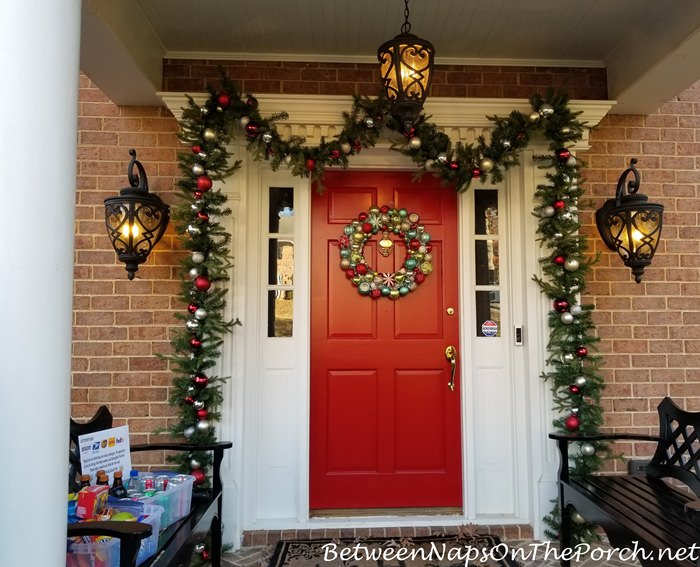 Oranment embellished garland around a front door
