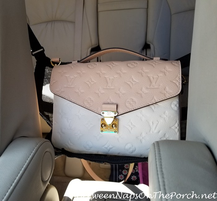 handbag holder for car keeps bag safe from sun damage out of the floor. Black Bedroom Furniture Sets. Home Design Ideas