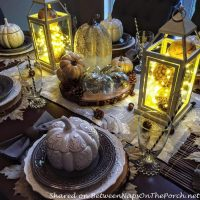 Lit Lanterns in a Fall-Autumn Centerpiece Display