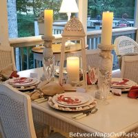 Candlelight Dining on Screened Porch, Beach-Themed Table, Crab-Lobster Plates, Shell Chargers, Shell Candle Holders