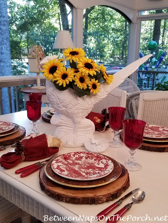White Pheasant Vase filled with Sunflowers for an Autumn Dinner on the Porch