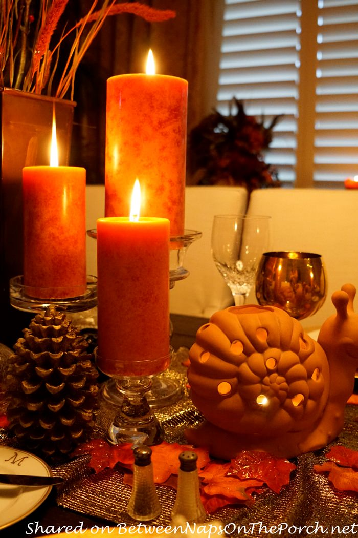 Orange Color candles create harmony for the mix of items, Thanksgiving Table