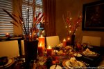 A Cozy, Candlelit Thanksgiving Table Setting
