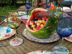 Spring Outdoor Table Setting with a Carved Watermelon Whale Centerpiece