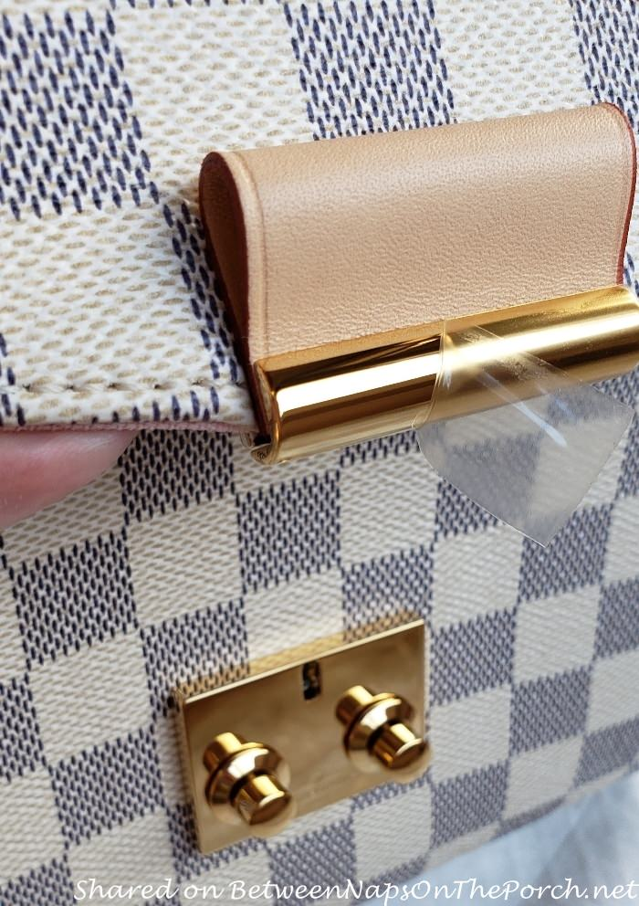 New Louis Vuitton Bag with Protective Plastic over Gold Metal Parts of Bag