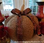 Autumn-Fall Table with a Woolly Throw Tablecloth and a Cozy Pumpkin Centerpiece