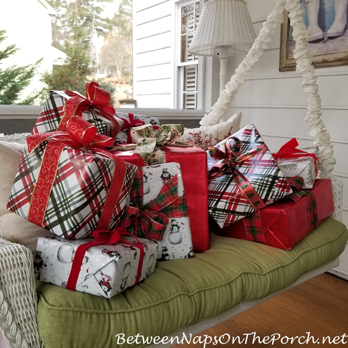 Christmas Porch Swing Filled with Presents for Christmas