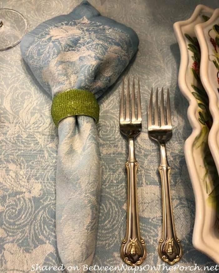 Napoleon bee flatware and green beaded napkin rings