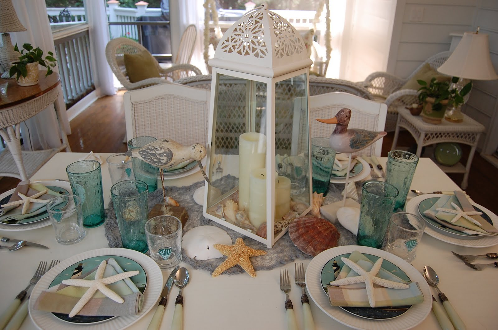Beach themed table setting with sailboat napkin fold and for Table setting design
