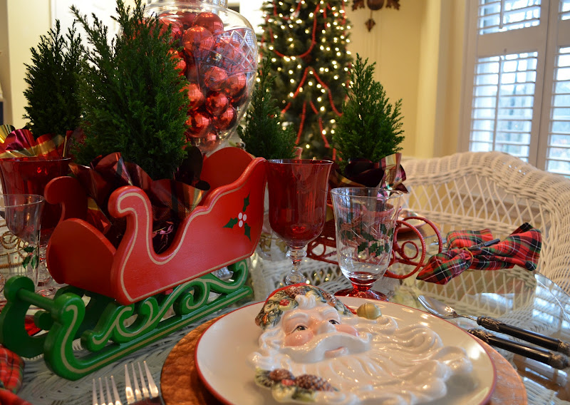 A Christmas Table Setting Tablescape with a Santa Claus Theme