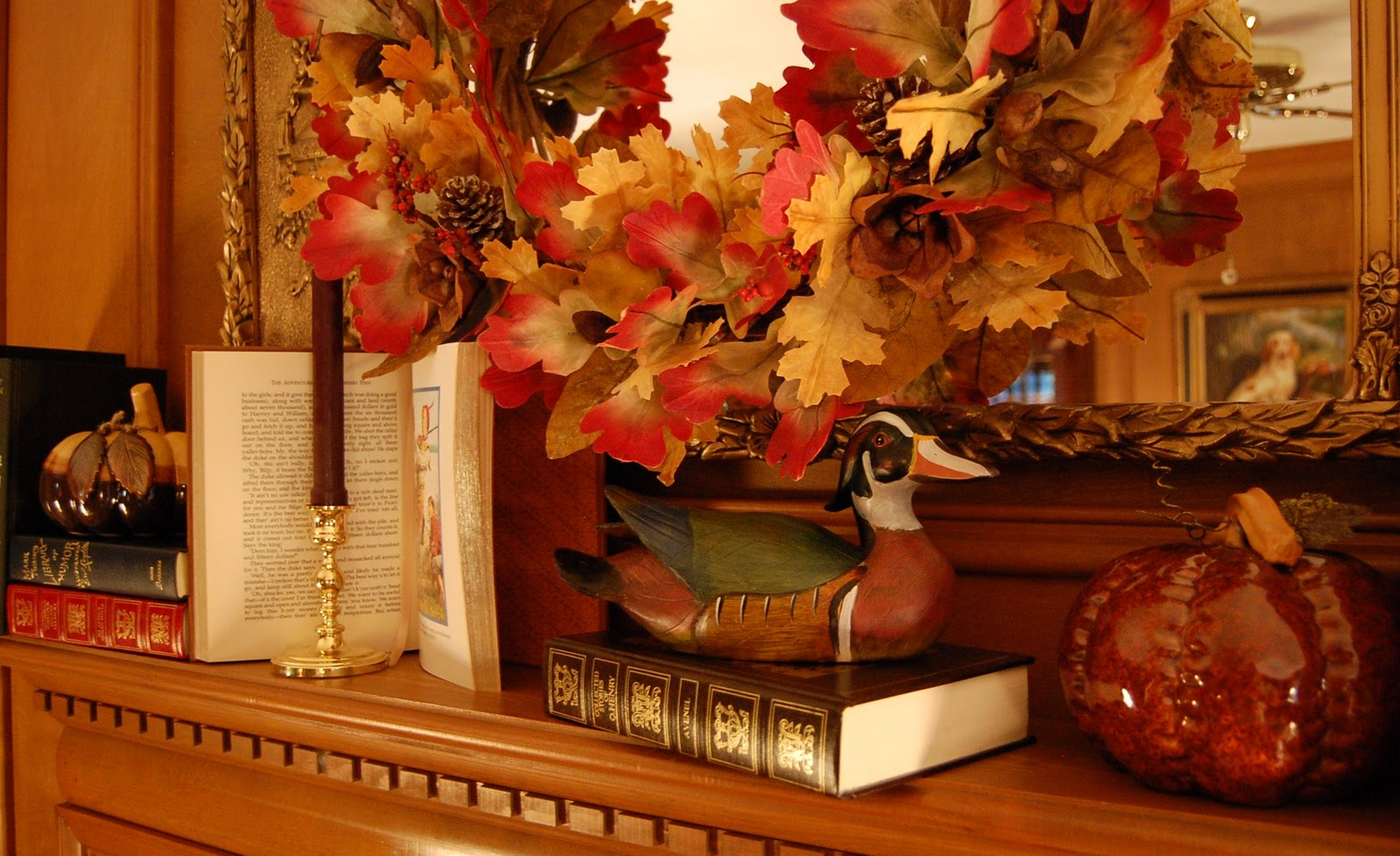 Decorate a fireplace mantel for fall or autumn with books for Autum decoration