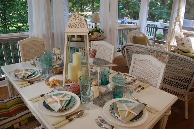 Beach Themed Table Setting with Sailboat Napkin Fold