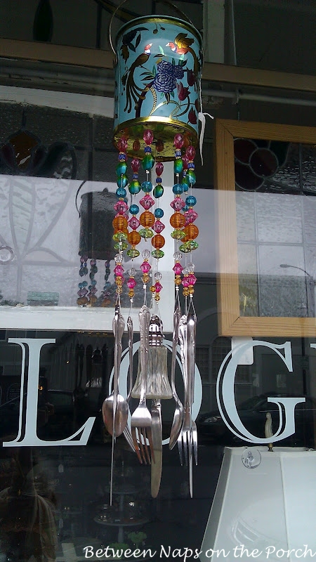 Wind Chime made from an old tin, beads and flatware.