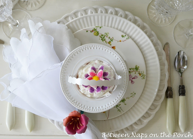 Easter Table Setting with Tulip Centerpiece and Pottery Barn Bunny Cup Cake Stands