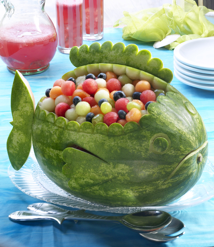 Carve a watermelon into creative shape for fun table
