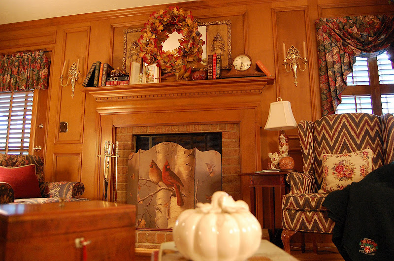 Decorate a fireplace mantel for Fall or Autumn with Books, Pumpkins and a fall wreath