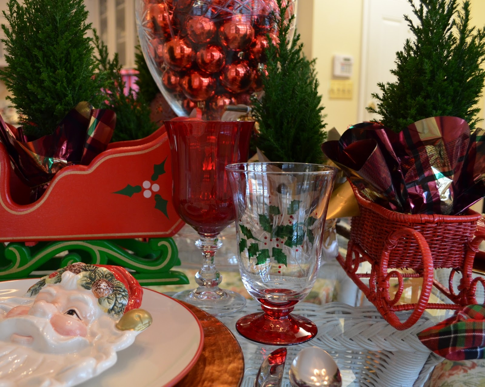 Santa Themed Tablescape With Plates And A Sleigh