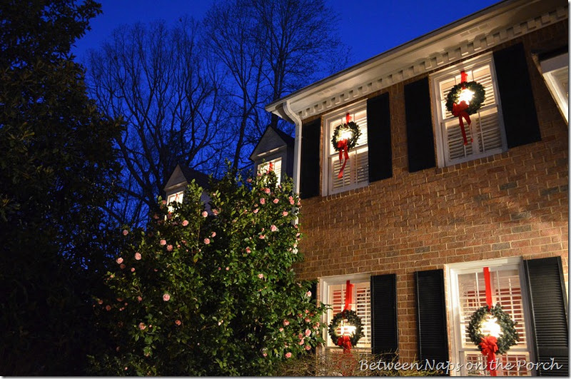 Front Porch Decorated for Christmas with Triple Wreaths on Door and Pottery Barn Knock-off Garland