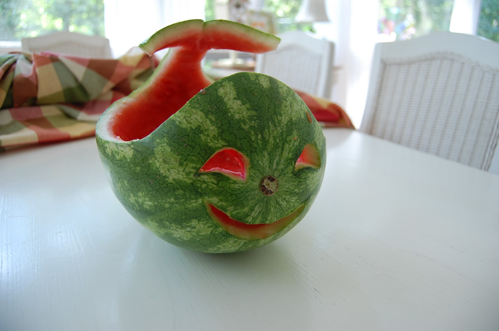 Carve a watermelon into creative shape for fun table