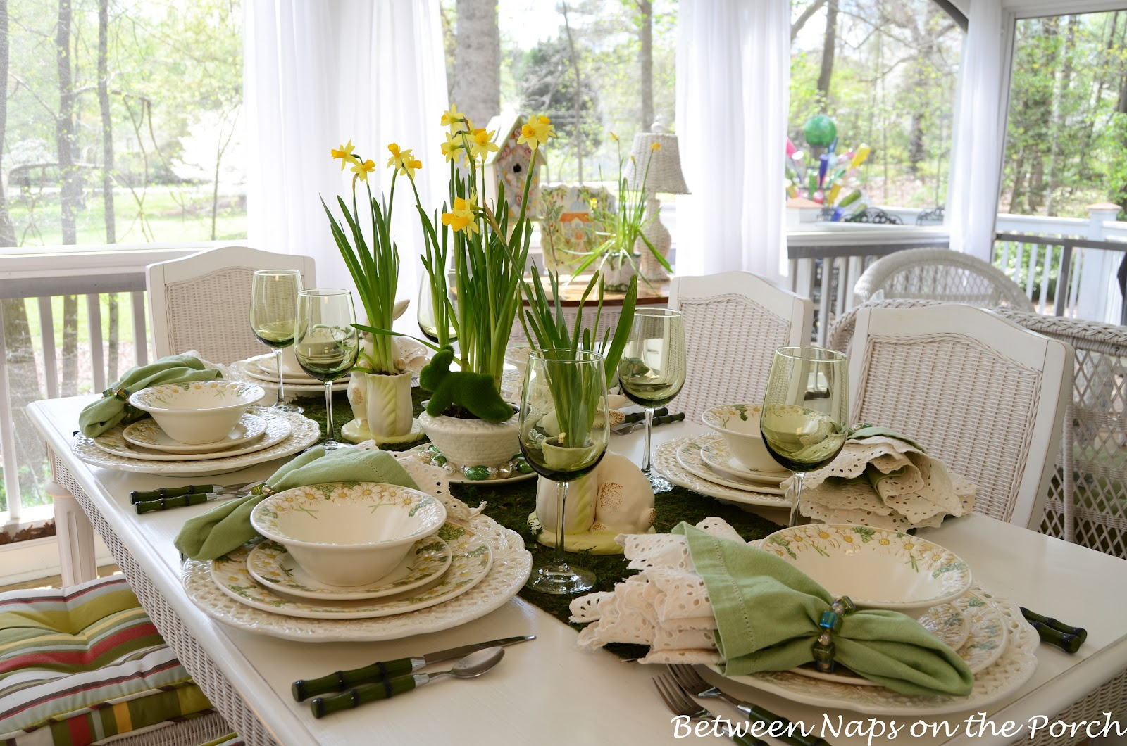 Easter table setting with daffodil and moss centerpiece for Table setting design