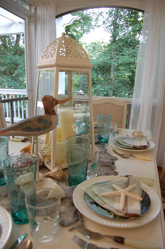 Beach Themed Table Setting with Sailboat Napkin Fold
