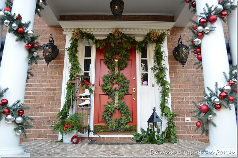 Front Porch Decorated for Christmas with Three Wreaths on Door and Pottery Barn Knock-off Garland