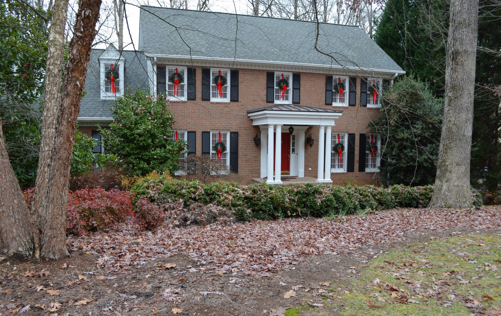 how to hang wreaths on outside exterior windows a previous year s view of the dormer windows with the garage windows below this pic was taken with the skinnier hanging ribbons before i changed them out