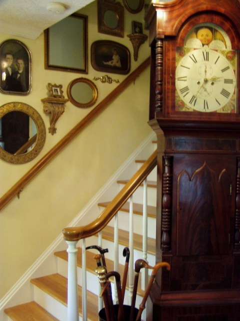Decorating A Staircase With Vintage Photos And Mirrors