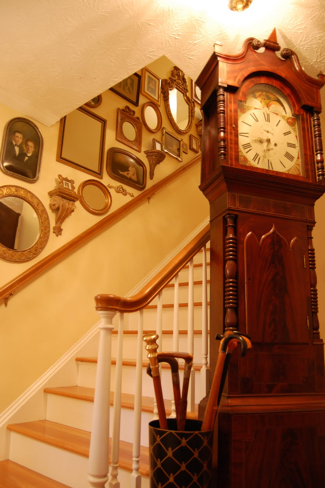 decorate staircases with vintage photos mirrors and small wall sconce