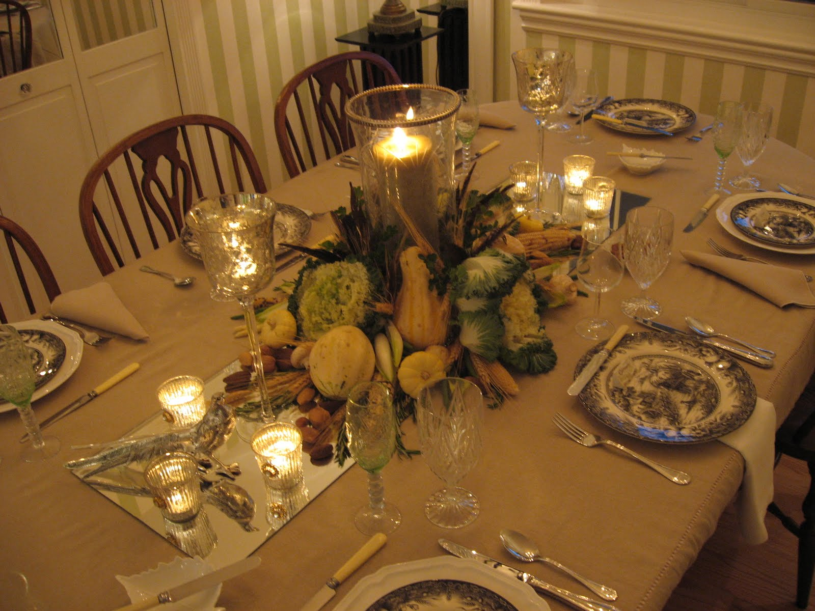 Fall Centerpieces With Feathers Thanksgiving With Candlelight And A Natural Centerpiece