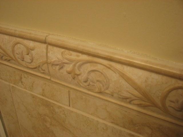 Tile trim work in bathroom renovation