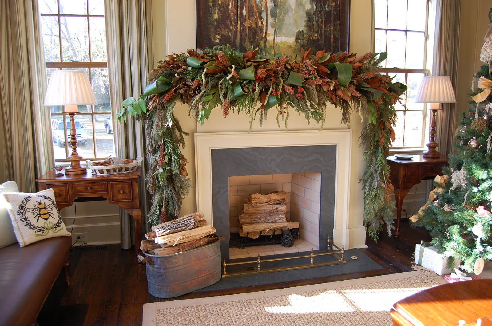 Christmas mantel decorated with natural greenery in Natural decorating