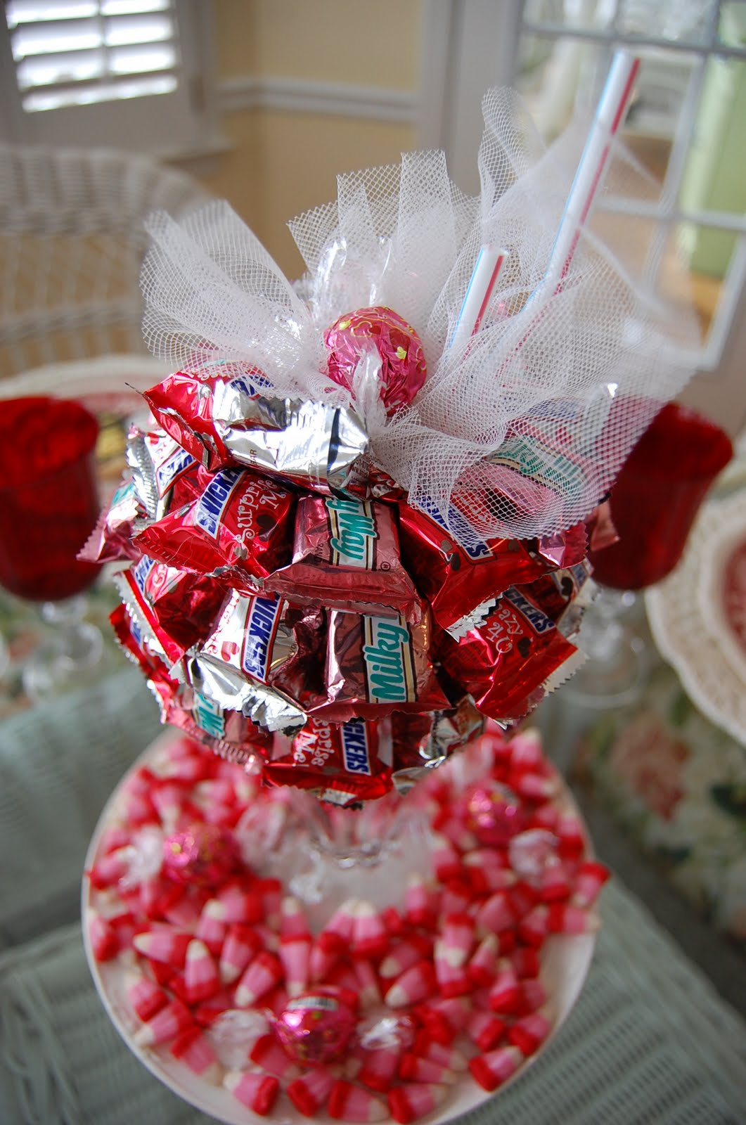 A valentine s day tablescape table setting with diy candy for B day decoration